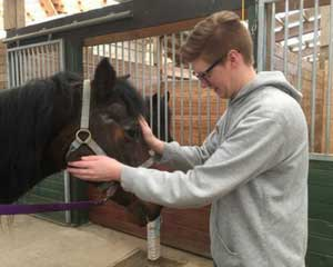 Pacific NW Horse and Dog Therapy Lucas with horse_web